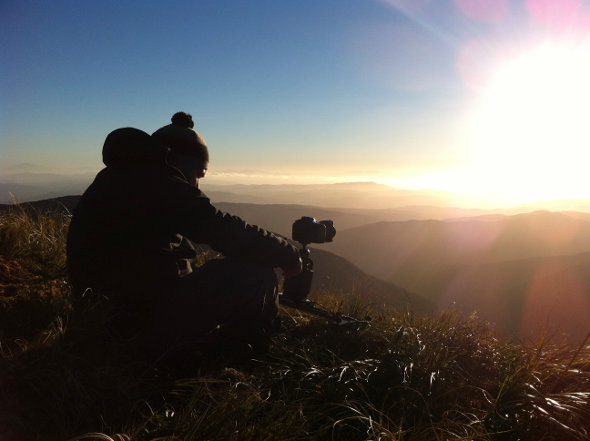 Mark Gee on top of the Tararua Range on the North Island of New Zealand setting up for a time-lapse.
