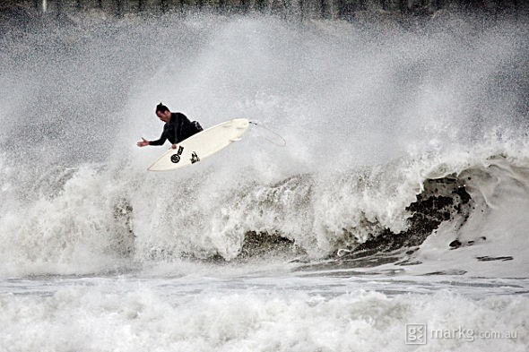 Matt Stockman getting some air in the corner at Lyall Bay, Wellington, New Zealand