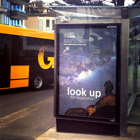 Look Up for inspiration as part of the Carter Observatory Light & Dark event campaign on the side of a bus shelter in Wellington, New Zealand.