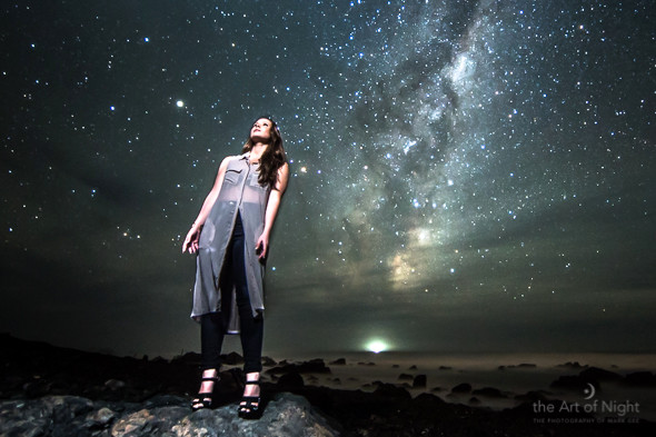 Sarah striking a pose with the rising Milky Way making for a stunning backdrop.