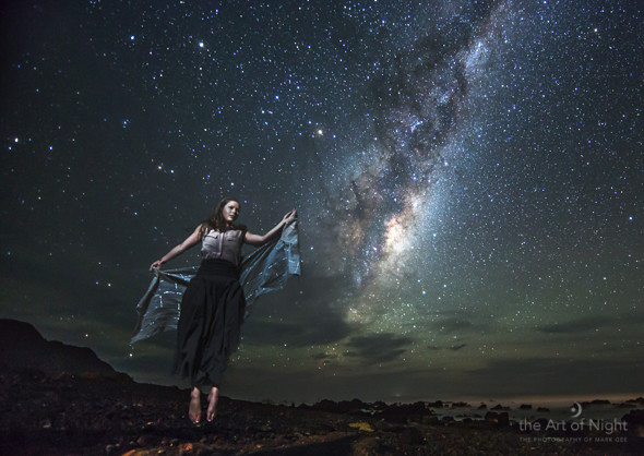 Levitation Under the Stars - a composite image consisting of Sarah in the foreground and the Milky Way and the night sky as the background.